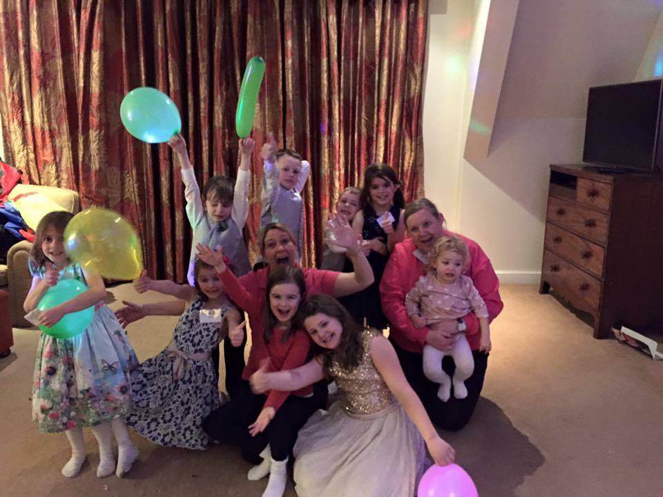 Lisa with a group of children in a hotel room for mobile creche