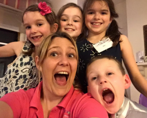 Lisa with 4 children smiling and laughing